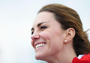 WEYMOUTH, ENGLAND - AUGUST 06:  Catherine, Duchess of Cambridge shares a joke with members of the Team GB sailing squad on Day 10 of the London 2012 Olympic Games at the Weymouth & Portland Venue at Weymouth Harbour on August 6, 2012 in Weymouth, England.  (Photo by Laurence Griffiths/Getty Images)